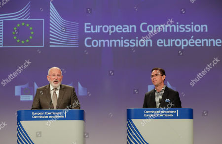Dutch Frans Timmermans (L), First Vice President of the European Commission and Commissioner for Better Regulation, Inter-Institutional Relations, Rule of Law and Charter of Fundamental Rights, together with Finnish Jyrki Katainen, European Commissioner for Jobs, Growth, Investment and Competitiveness, hold a joint press conference on protecting and restoring the world's forests at the European Commission in Brussels, Belgium, 23 July 2019.