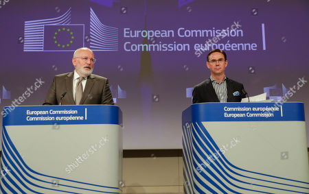 Stock Photo of Dutch Frans Timmermans (L), First Vice President of the European Commission and Commissioner for Better Regulation, Inter-Institutional Relations, Rule of Law and Charter of Fundamental Rights, together with Finnish Jyrki Katainen, European Commissioner for Jobs, Growth, Investment and Competitiveness, hold a joint press conference on protecting and restoring the world's forests at the European Commission in Brussels, Belgium, 23 July 2019.
