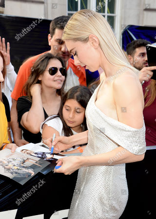 Vanessa Kirby signing autographs for fans