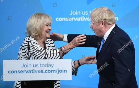 Boris Johnson (R) is hugged by Cheryl Gillan (L), acting Chairman of the 1922 Committee, reacts as he is announced as the new Conservative party leader at an event in London, Britain, 23 July 2019. Former London mayor and foreign secretary Boris Johnson on 23 July 2019 was announced the winner in the party contest to replace Theresa May as leader of the Conservative Party. As the winner, Johnson will also take up the post of Britain's prime minister on 24 July 2019.