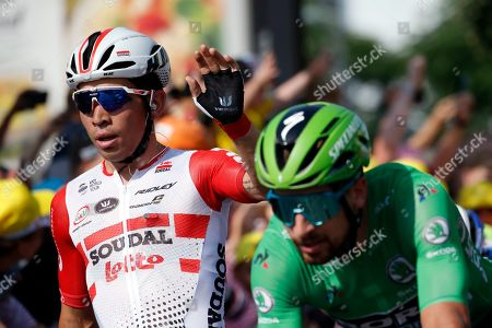 Australia's Caleb Ewan, left, celebrates as crosses the finish line with Slovakia's Peter Sagan to win the sixteenth stage of the Tour de France cycling race over 117 kilometers (73 miles) with start and finish in Nimes, France
