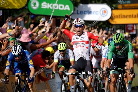 Australia's Caleb Ewan, center, celebrates as crosses the finish line with Slovakia's Peter Sagan to win the sixteenth stage of the Tour de France cycling race over 117 kilometers (73 miles) with start and finish in Nimes, France