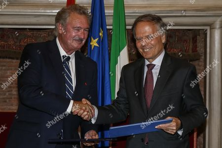 Italian Foreign Minister Enzo Moavero Milanesi (R) shakes hands with Luxembourg Foreign Minister Jean Asselborn (L), during a signing of agreements at the end of bilateral meeting in Villa Madama, in Rome, Italy, 23 July 2019.