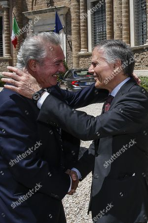 Italian Foreign Minister Enzo Moavero Milanesi (R) welcomes Luxembourg Foreign Minister Jean Asselborn (L), during a bilateral meeting at Villa Madama, in Rome, Italy, 23 July 2019.