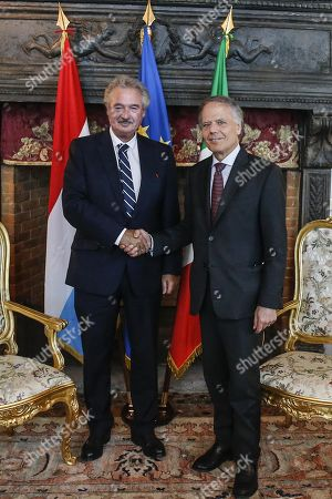Italian Foreign Minister Enzo Moavero Milanesi (R) shakes hands with Luxembourg Foreign Minister Jean Asselborn (L), during a bilateral meeting at Villa Madama, in Rome, Italy, 23 July 2019.