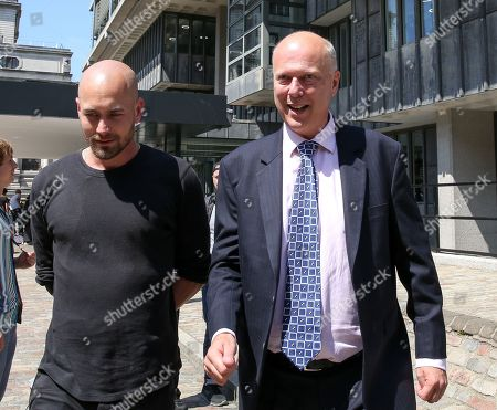 Chris Grayling, Secretary of State for Transport leaves the QEII Centre after Boris Johnson is elected as leader of the Conservative Party and the new British Prime Minister
