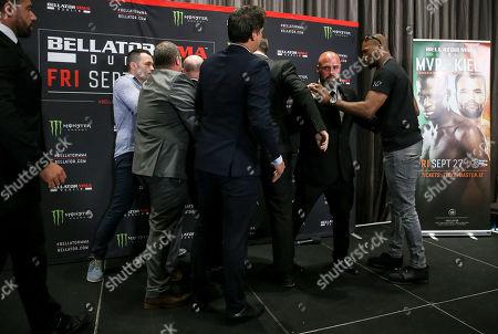 Stock Image of Michael 'Venom' Page and Richard Kiely scuffle