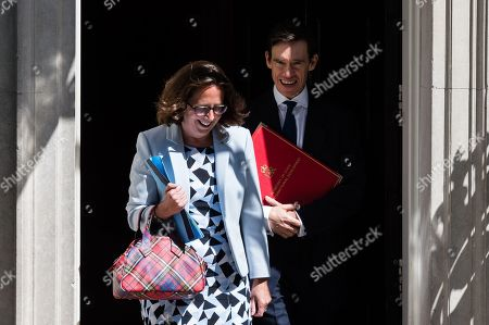 Leader of the House of Lords and Lord Privy Seal Natalie Evans (L) and Secretary of State for International Development Rory Stewart (R) leave 10 Downing Street after Theresa May's final cabinet meeting as Prime Minister.