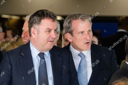 Lord President of the Council and Leader of the House of Commons Mel Stride (L) and Secretary of State for Education Damian Hinds (R) leave the Queen Elizabeth II conference centre in Westminster following announcement of the result of the Conservative Party leadership contest.