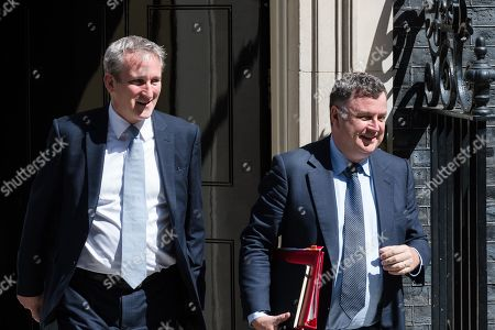 Secretary of State for Education Damian Hinds (L) and Lord President of the Council and Leader of the House of Commons Mel Stride (R) leave 10 Downing Street after Theresa May's final cabinet meeting as Prime Minister.
