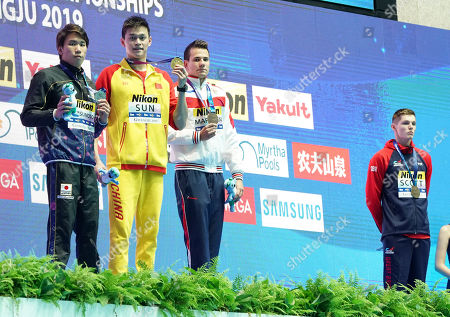 Gold medalist Sun Yang of China, silver medalist Katsuhiro Matsumoto of Japan and joint bronze medal winners Martin Malyutin  of Russia and Duncan Scott of Great Britain during the medal ceremony for the men's 200m Freestyle final
