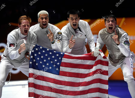 Members of the American team, Miles Chamley-Watson, Race Imboden, Alexander Massialas and Gerek Meinhardt celebrate after they defeated France in the final of men's foil team competition of the FIE World Fencing Championships in Budapest, Hungary, 23 July 2019.