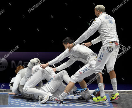 Members of the American team, Miles Chamley-Watson, Alexander Massialas, Race Imboden and Gerek Meinhardt, celebrate after they defeated France in the final of men's foil team competition of the FIE World Fencing Championships in Budapest, Hungary, 23 July 2019.