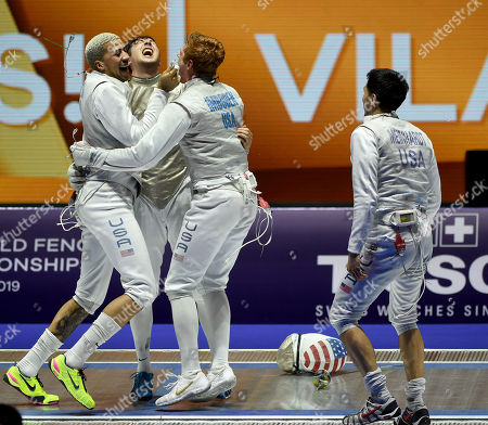 Members of the American team, Miles Chamley-Watson, Alexander Massialas, Race Imboden and Gerek Meinhardt (L-R) celebrate after they defeated France in the final of men's foil team competition of the FIE World Fencing Championships in Budapest, Hungary, 23 July 2019.