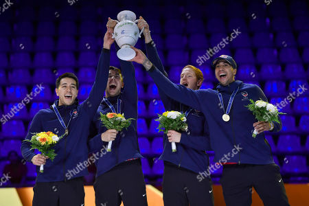 Gold medal winning Alexander Massialas, Gerek Meinhardt, Race Imboden and Miles Chamley-Watson (L-R) of the US celebrate during the medal ceremony after they defeated France in the final of men's foil team competition of the FIE World Fencing Championships in Budapest, Hungary, 23 July 2019.