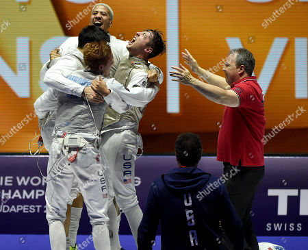 Members of the US American team, Miles Chamley-Watson, Alexander Massialas, Race Imboden and Gerek Meinhardt, celebrate after they defeated France in the final of men's foil team competition of the FIE World Fencing Championships in Budapest, Hungary, 23 July 2019.