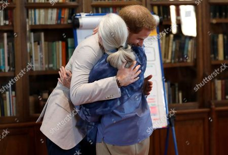 Britain's Prince Harry and Dr Jane Goodall hug as he attends Dr Jane Goodall's Roots & Shoots Global Leadership Meeting at St. George's House, Windsor Castle in England, . Roots & Shoots is a global programme empowering young people of all ages, working to ignite and inspire the belief that every individual can take action to make the world a better place for people, animals and the environment