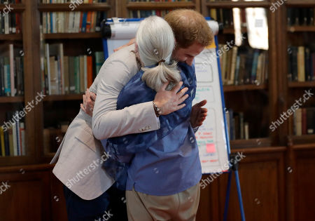 Britain's Prince Harry, Prince Harry and Jane Goodall hug as he attends Dr Jane Goodall's Roots & Shoots Global Leadership Meeting at St. George's House, Windsor Castle in England,. Roots & Shoots is a global programme empowering young people of all ages, working to ignite and inspire the belief that every individual can take action to make the world a better place for people, animals and the environment