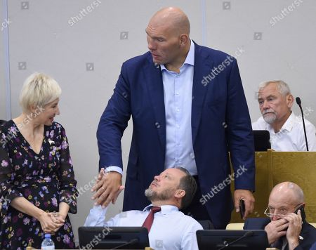 Stock Photo of Left to right: Olga Pavlova, member of the State Duma Committee for Labor, Social Policy and Veterans; Alexander Sholokhov, Deputy Chairman of the State Duma Committee for Culture; Nikolai Valuev, First Deputy Chairman of the Russian State Duma Committee for Ecology and Environment Protection; Vadim Bulavinov, Deputy Chairman of the Russian State Duma Committee for Housing and Communal services; and Ivan Firulin, member of the State Duma Committee for Regional Policy and Problems of the North and the Far East.