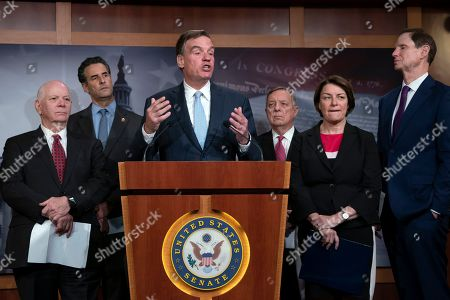 Mark Warner, Amy Klobuchar, Dick Durbin, Ben Cardin, John Sarbanes, Ron Wyden. Sen. Mark Warner, D-Va., vice-chair of the Senate Intelligence Committee, is joined by fellow Democrats as he tells reporters that the Republicans have killed every piece of legislation the Democrats have crafted to protect elections, during a news conference at the Capitol in Washington, . Warner is joined by, from left, Sen. Ben Cardin, D-Md., Rep. John Sarbanes, D-Md., Sen. Dick Durbin, D-Ill., Sen. Amy Klobuchar, D-Minn., and Sen. Ron Wyden, D-Ore