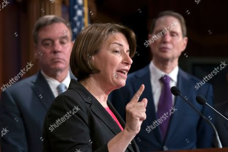 Mark Warner, Amy Klobuchar, Ron Wyden. Sen. Amy Klobuchar, D-Minn., is flanked by Sen. Mark Warner, D-Va., vice-chair of the Senate Intelligence Committee, left, and Sen. Ron Wyden, D-Ore., as they tell reporters that Republicans have stopped every piece of legislation Democrats have crafted to protect elections that have been introduced in the Senate or passed in the House, at a news conference at the Capitol in Washington