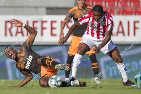 Stock Picture of Valencia's Geoffrey Kondogbia, left, fights for the ball with Sion's Alexandre Song, right, during a friendly soccer match between FC Sion from Switzerland and Valencia CF from Spain, at the stade de Tourbillon stadium, in Sion, Switzerland, Tuesday, July 23, 2019.