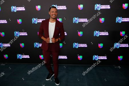 Mexican actor Luis Sandoval pose for a photo as he walks the red carpet before the start of the Premios Juventud 2019, Latin awards show, in Coral Gables, Fla