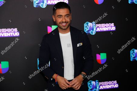 Spanish actor Borja Voces poses for a photo as he walks the red carpet before the start of the Premios Juventud 2019, Latin awards show, in Coral Gables, Fla