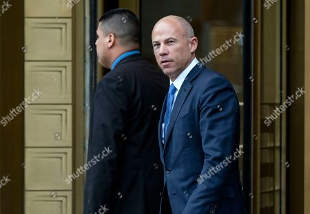 California attorney Michael Avenatti walks from a courthouse in New York, after facing charges accusing him of cheating porn star Stormy Daniels out of $300,000 in a book deal