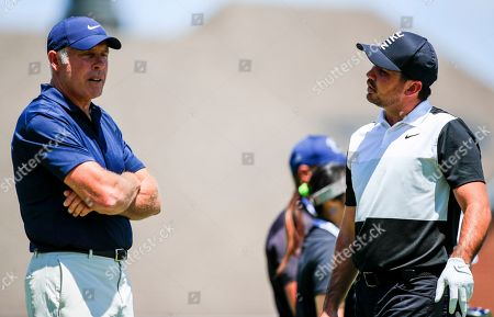 Jason Day of Australia (R) talks with caddie Steve Williams during practice for the FedEx St. Jude Invitational World Golf Championships tournament at TPC Southwind in Memphis, Tennessee, USA, 23 July 2019. Championship play runs 25 July to 28 July.