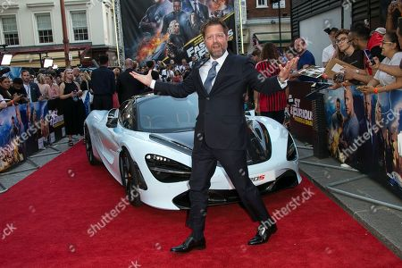David Leitch poses for photographers at a special screening of Fast & Furious: Hobbs & Shaw, in a central London cinema