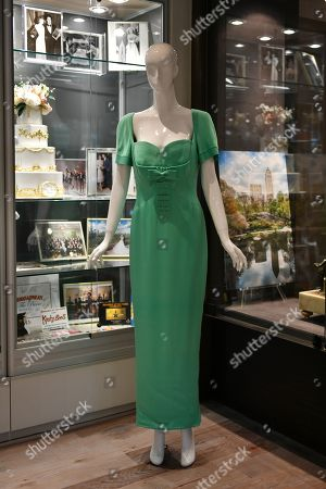 Elizabeth Taylor's Gianni Versace green silk evening dress with short sleeves and bow fitted bodice, zip up the back.  Labeled 'Atelier Versace.' Circa 1990s