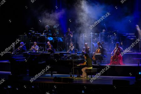 Greek pianist and composer Yanni (C) performs during a concert at the seaside waterfront of Beirut, during the Beirut Holidays 2019 festival, Lebanon, 23 July 2019.