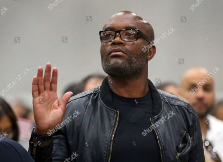 """Mixed martial arts great Anderson """"Spider"""" Silva of Brazil is sworn in as a U.S. citizen along with thousands of others in a mass naturalization ceremony Tuesday at the Los Angeles Convention Center"""