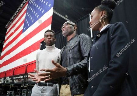 """Mixed martial arts great Anderson """"Spider"""" Silva of Brazil, daughter Kaory, 23, right, and son Kalyl, 20, left, talk to reporters after all were sworn in as U.S. citizens in a mass naturalization ceremony Tuesday at the Los Angeles Convention Center"""