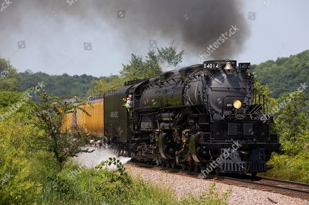 The 133-foot-long Big Boy No. 4014 steam locomotive leads a train, in Knapp, Wis. The locomotive and train are on a tour of the Midwest. The locomotive, built in 1941, was recently restored