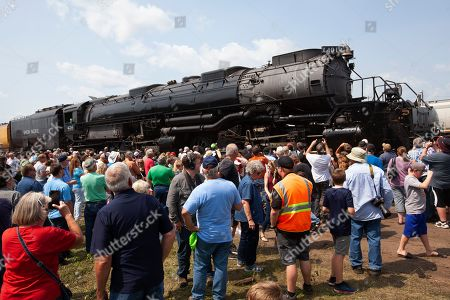 People look at and take pictures of Union Pacific Big Boy steam locomotive 4014, which had stopped in Altoona, Wis., after a run from St. Paul, Minn