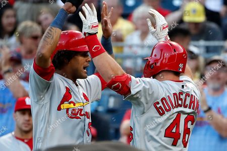 St. Louis Cardinals' Paul Goldschmidt (46) is greeted by Jose Martinez after hitting a two-run home run off Pittsburgh Pirates starting pitcher Chris Archer during the third inning of a baseball game in Pittsburgh