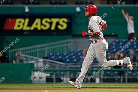 St. Louis Cardinals' Jose Martinez rounds first base after hitting a solo home run off Pittsburgh Pirates starting pitcher Chris Archer during the fifth inning of a baseball game in Pittsburgh