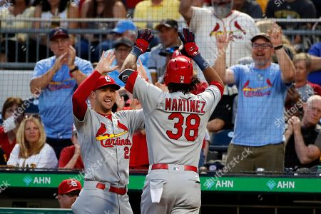Jack Flaherty, Jose Martinez. St. Louis Cardinals' Jose Martinez (38) is greeted at the dugout steps by Jack Flaherty after hitting a solo home run off Pittsburgh Pirates starting pitcher Chris Archer during the fifth inning of a baseball game in Pittsburgh