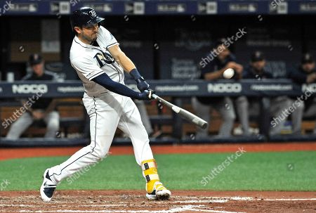 Stock Picture of Tampa Bay Rays' Travis d'Arnaud hits a two-run home run off Boston Red Sox starter Chris sale during the third inning of a baseball game, in St. Petersburg, Fla