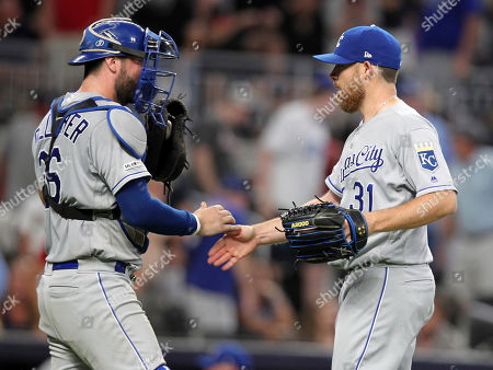 Kansas City Royals' Ian Kennedy, right, celebrates with catcher Cam Gallagher after striking out an Atlanta Braves batter to end the baseball game, in Atlanta. The Royals defeated the Braves 5-4