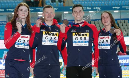 Bronze medal winners from left, Britain's Freya Anderson, Adam Peaty, James Guy and Georgia Davies pose with their medals after the 4x100m medley relay final and at the World Swimming Championships in Gwangju, South Korea