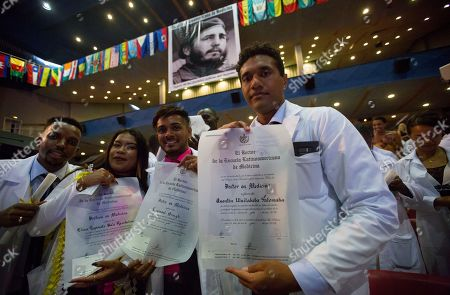 Stock Picture of Young graduates from different countries pose with their diplomas during the fifteenth graduation of the Latin American School of Medicine, at the Karl Marx Theater in Havana, Cuba, 23 July 2019. Approximately 500 medical students from 84 countries graduated from the school in Havana during a ceremony on 23 July.