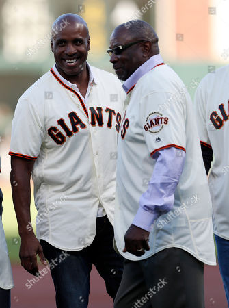 Former San Francisco manager Dusty Baker (R) and former San Francisco Giants Barry Bonds (L) are introduced during the Giants African-American Heritage Night celebration against the Chicago Cubs at Oracle Park in San Francisco, California, USA, 23 July 2019.