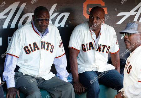 Stock Photo of Former San Francisco manager Dusty Baker (L) and former San Francisco Giants Barry Bonds (R) sit in the dugout prior to Giants African-American Heritage Night against the Chicago Cubs at Oracle Park in San Francisco, California, USA, 23 July 2019.