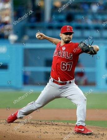Los Angeles Angels starting pitcher Taylor Cole throws to the Los Angeles Dodgers during the first inning of a baseball game, in Los Angeles