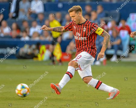 AC Milan midfielder, Lucas Biglia (20), during the International Champions Cup match between AC Milan and FC Bayern, at Children's Mercy Park in Kansas City, KS. Bayern defeated AC Milan, 1-0. Kevin Langley/Sports South Media/CSM