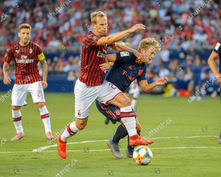 Stock Photo of AC Milan defender, Ivan Strinic (23), and Bayern forward, Fiete Arp (15), clash while working for ball control during the International Champions Cup match between AC Milan and FC Bayern, at Children's Mercy Park in Kansas City, KS. Bayern defeated AC Milan, 1-0. Kevin Langley/Sports South Media/CSM
