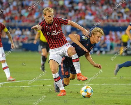 AC Milan defender, Ivan Strinic (23), and Bayern forward, Fiete Arp (15), clash while working for ball control during the International Champions Cup match between AC Milan and FC Bayern, at Children's Mercy Park in Kansas City, KS. Bayern defeated AC Milan, 1-0. Kevin Langley/Sports South Media/CSM